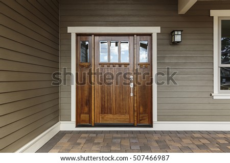 Front dark brown door that is closed