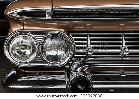 Front detail of a vintage car - stock photo