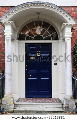Front Door and Porch of an Attractive Georgian Era London Town House - stock photo