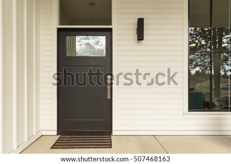 Front door, front view of a brown door
