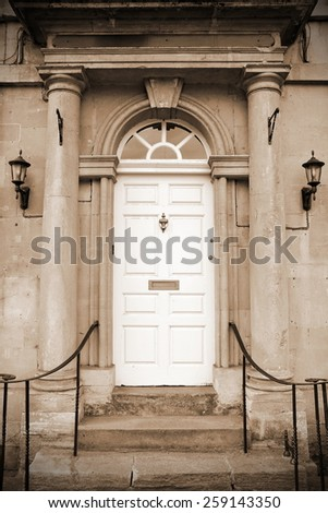 Front Door of a Beautiful Old London Town House in Sepia - stock photo