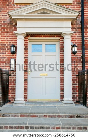 Front Door of a Beautiful Red Brick London Town House - stock photo