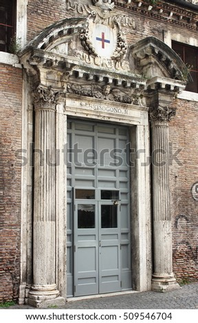 Front door of a medieval church in Rome, Italy