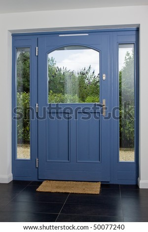 Front door of a newly built modern property - stock photo