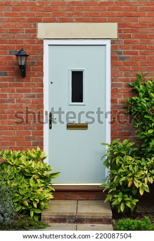 Front Door of an Attractive Red Brick Town House on a Typical English Residential Estate - stock photo