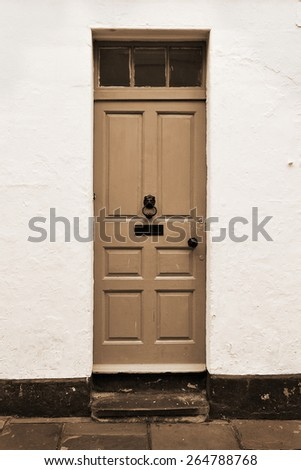 Front Door of an Old London Town House in Sepia - stock photo