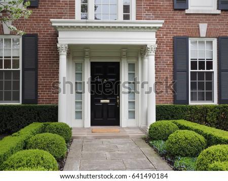 front door of house with elegant portico entrance & Front Door Portico Stock Photo 725747494 - Shutterstock pezcame.com