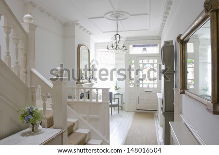 Front door with entrance hall of house - stock photo