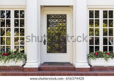 Front door with lots of windows