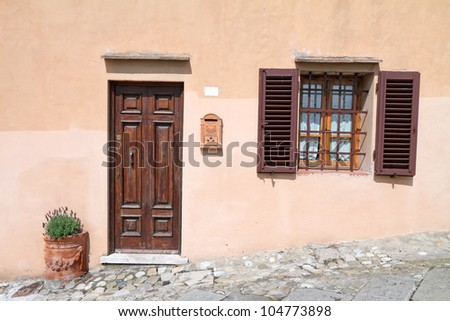 front door with terracotta letterbox and flowerpot with lavender plant,Certaldo, Tuscany, Italy, Europe - stock photo