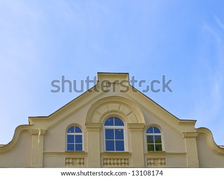 front elevation of a penthouse against blue sky - stock photo