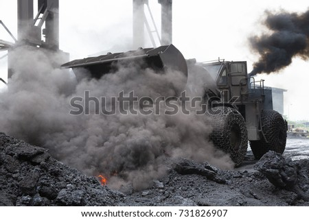 front end loader during carry hot slag from electric arc furnace