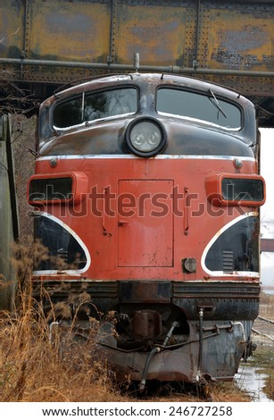 Front end view of an old abandoned locomotive in a train yard - stock photo