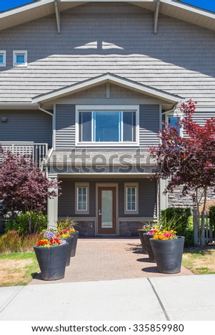 Front entrance to the townhouse in a residential neighbourhood in Canada. - stock photo