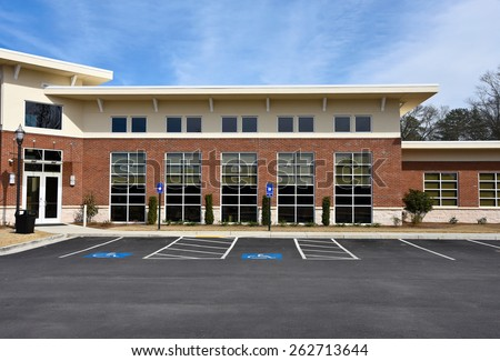 Front Facade of a New Commercial Building with Office Space available for sale or lease - stock photo
