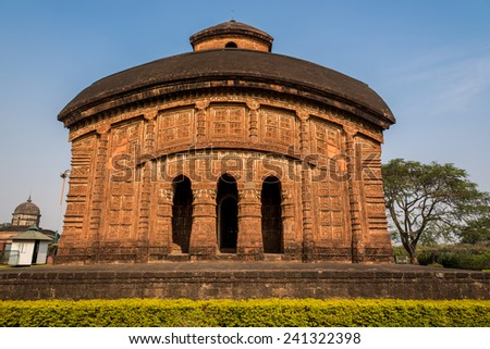 Front face of Jorbangla temple showing beautiful terracotta carvings on the walls. - stock photo