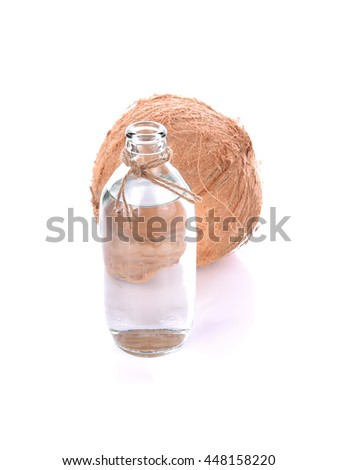 front focus Coconut oil isolated on white backgroung. - stock photo