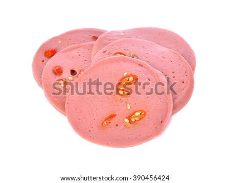 front focus ham sausage chilli or rolled bologna slices isolated on white background. - stock photo
