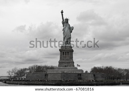 Front full view of the Statue of Liberty, on a cloudy background. - stock photo
