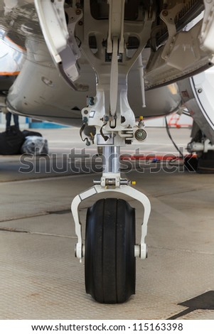 front landing gear light aircraft on the ground - stock photo
