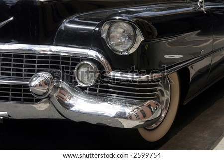 Front Lights Of An Old Black Vintage Car On The Street