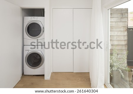 Front load washer and dryer with open closet. Great design idea when there is no laundry room. - stock photo