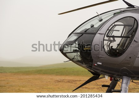 Front of a helicopter on a foggy day.