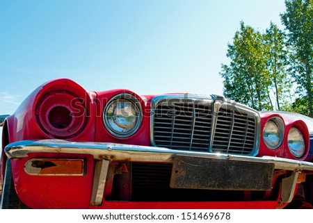 Front of a Jaguar XJ6 in a junkyard - stock photo