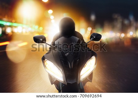 front of a motorcycle at night