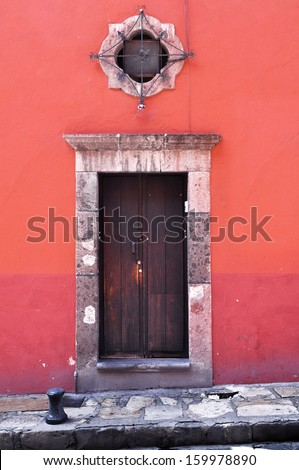 Front of an old mexican house - Colonial style door and window - San Miguel de Allende Mexico - stock photo