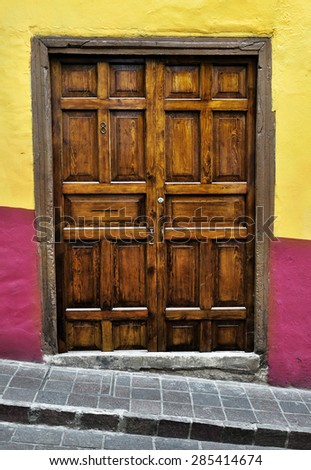 Front of an old mexican house - Colonial style door - Guanajuato Mexico - stock photo