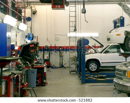 Front of automobile service bay with mechanic's benches and tools