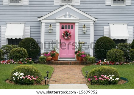front of beautiful house and garden