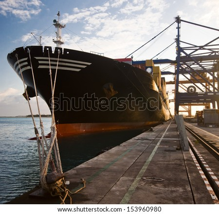 Front of Cargo ship loading containers - stock photo