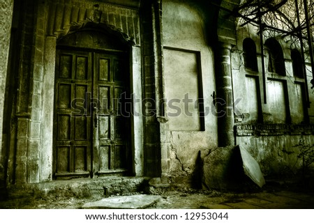 Front of creepy old house - vintage greenish version - stock photo