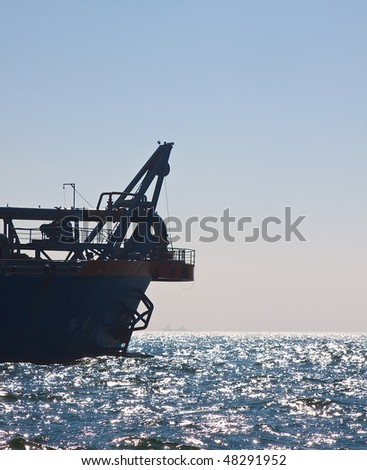 Front of dredger back lit - stock photo