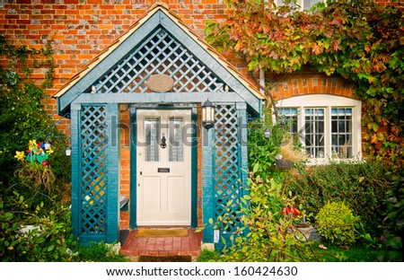 front of english house in autumn - stock photo