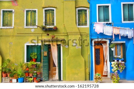front of houses in a street painted in bright colors - stock photo