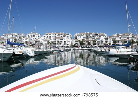 Front of luxury speedboat heading into port of Puerto Banus in Spain - stock photo