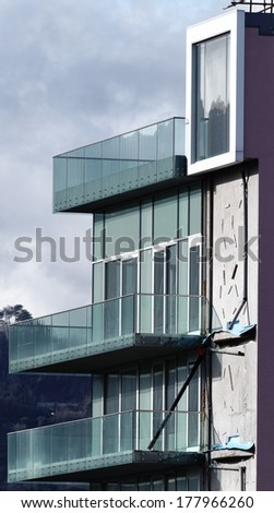 front of modern building in a town in italy - stock photo
