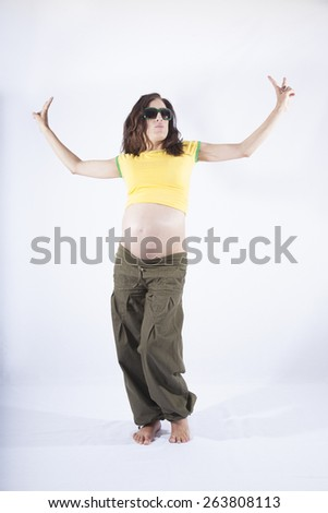front of naked paunch eight month pregnant woman with brazilian colors shirt celebrating success winner isolated on over white background
