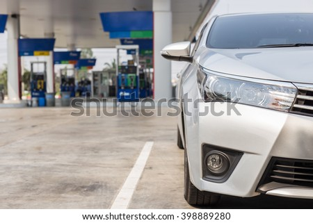 Front of new silver car parking in gas station in Thailand - stock photo