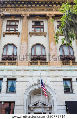 Front of old Scottish Rite temple in Savannah Georgia with American flag out front