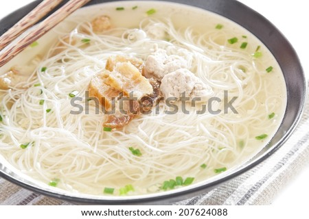 Front of Pho Lao style noodle soup with vegetables and pork on table - stock photo