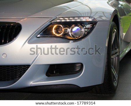 Front of silver luxury car - stock photo