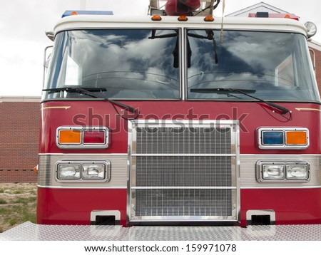 Front of the fire truck at the fire station. - stock photo