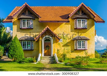 Front of vintage yellow European style house in countryside of Mae Hong Son province, Northern Thailand