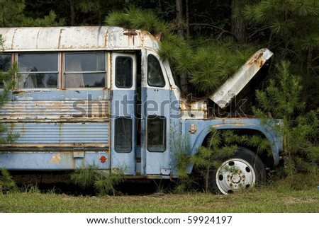 Front on old rusted junk bus