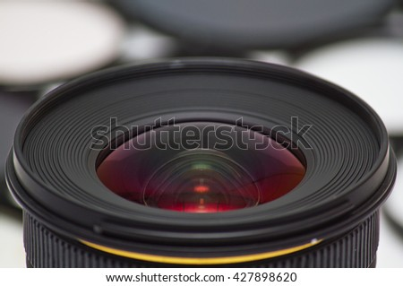 Front optic glass on camera lenses