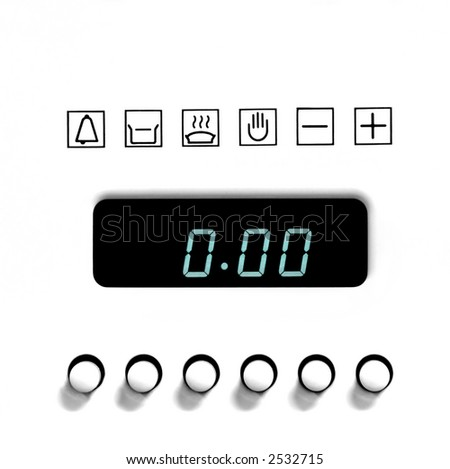 Front panel of kitchen oven with clock - stock photo